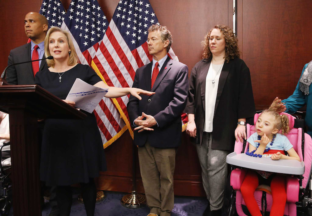 Senators Booker, Paul and Gillibrand at the press conference introducing the CARERS Act